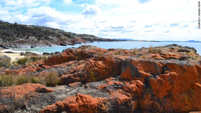 "Lichen-tainted rocks at Spikey Beach in Tasmania, Australia, ""paint the world in peaceful orange,"" writes <a href='http://ireport.cnn.com/docs/DOC-1184668'>Steven Kemp</a>, a retired air traffic controller. ""In a world of turmoil, orange can be meditative."""