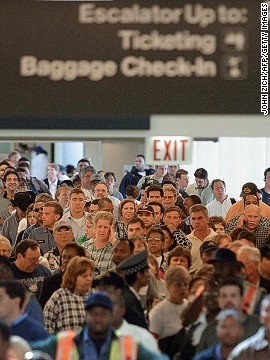 With tens of thousands returning home on the Sunday after Thanksgiving, the line for security screening at Chicago Midway International Airport was measured at 1.2 miles long. (File photo)