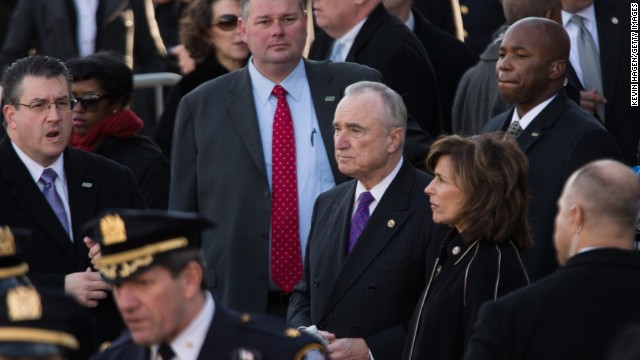Police Commissioner Bill Bratton, center, arrives with his wife, Rikki Klieman.