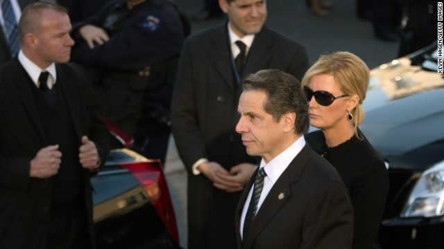 New York Gov. Andrew Cuomo arrives at the funeral with his girlfriend Sandra Lee.