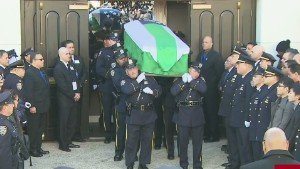 Thousands honor slain NYPD officer