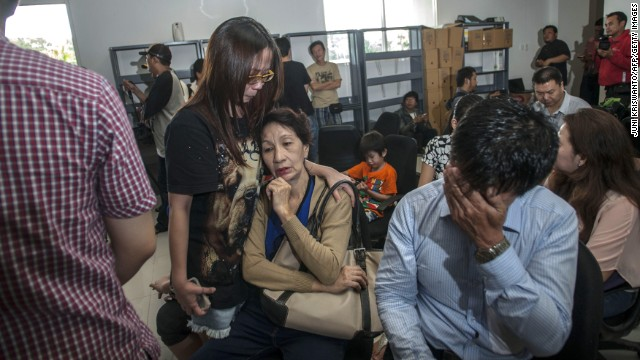 Family members of passengers on missing AirAsia Flight QZ8501 gather at Juanda International Airport in East Java, Indonesia, on Sunday, December 28. The passenger jet carrying 162 people lost contact with Indonesian air traffic control early Sunday, gripping Southeast Asia with a second missing plane crisis in less than a year.