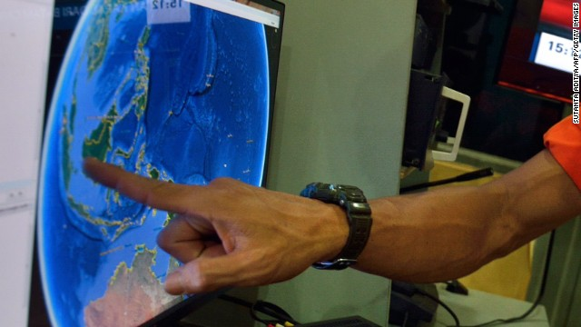 An official from Indonesia's national search and rescue agency points to the position where AirAsia Flight QZ8501 went missing. Before communication was lost, a pilot asked to deviate from its planned route -- from the Indonesian city of Surabaya to Singapore -- because of bad weather, officials said.