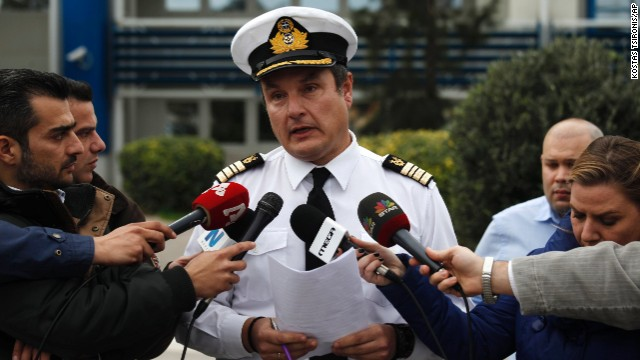 Greece's Coast Guard spokesman Nikolaos Lagadianos delivers a statement concerning the fire to the media in Piraeus port.