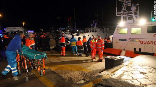 Paramedics wait for rescued passengers from the Italian-flagged Norman Atlantic after it caught fire in the Adriatic Sea on Sunday, December 28. The ferry, carrying hundreds of passengers, caught fire early Sunday, trapping passengers on the top decks as gale-force winds and choppy seas hampered the evacuation.