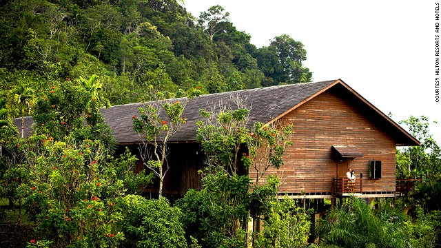 The Hilton longhouse hotel is modeled on traditional communal living spaces used by Iban tribes.