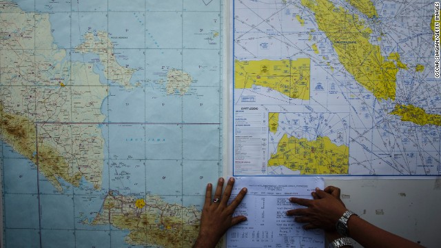 Smoke spotted as searchers look for missing AirAsia jet
