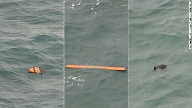 This aerial view taken from an Indonesian search and rescue aircraft over the Java Sea shows floating debris spotted in the same area as other items being investigated by Indonesian authorities as possible objects from missing AirAsia flight QZ8501 on December 30, 2014. Dozens of planes and ships have been searching Indonesian waters for the missing AirAsia jet carrying 162 people that lost contact with Indonesian air traffic control early Sunday.