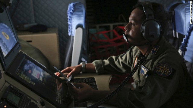 An Indonesian navy member monitors a radar screen during a search operation over the waters near Bangka Island, Indonesia, on December 30.