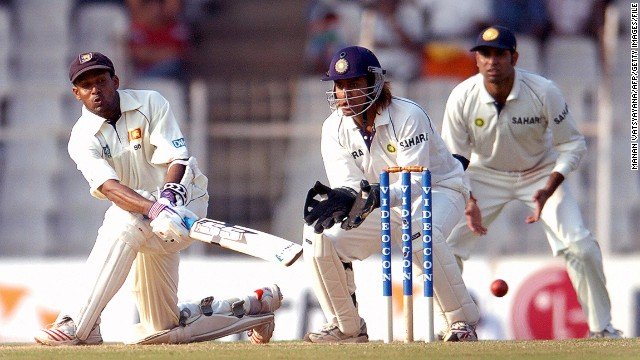 Dhoni keeping wicket during his Test debut against Sri Lanka in 2005. He would prove a reliable presence behind the stumps, claiming 256 catches and 38 stumpings.