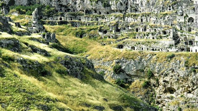 """For centuries, Matera's 156 rock crypts and maze of grottoes were home to """"troglodyte"""" outcasts living in inhuman conditions."""