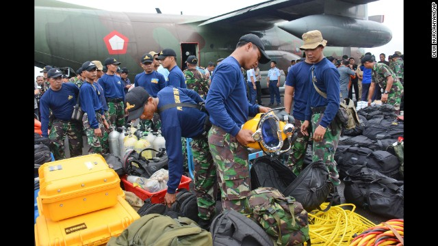 Indonesian navy divers inspect their gear in Pangkalan Bun, Indonesia, before a search operation December 31.
