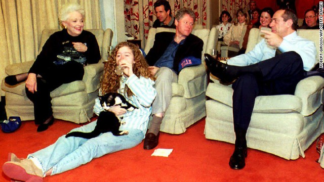 U.S. President Bill Clinton, center, chats with Cuomo and Texas Gov. Ann Richards, while Chelsea Clinton sits on floor, on January 31, 1993, at the White House while watching the Super Bowl.