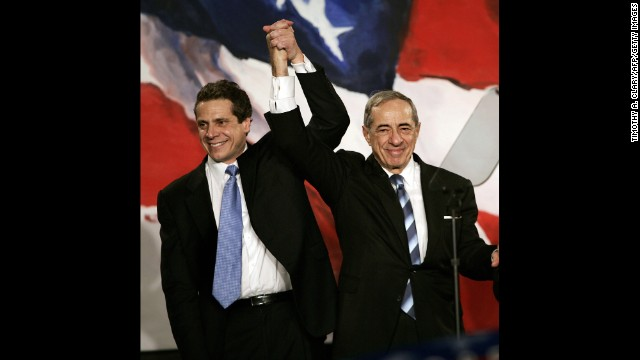 New York Attorney General Elect Andrew Cuomo joins hands with his father during a rally held by Democrats in New York on November 7, 2006.