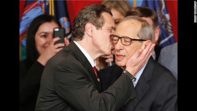 Gov. Andrew Cuomo kisses his father, celebrating his defeat of Republican challenger Rob Astorino, at Democratic election headquarters in New York on November 4, 2014.