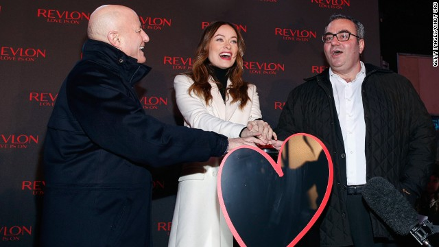 Revlon CEO Lorenzo Delpani, at right with company investor Ron Perelman and actress Olivia Wilde, is facing a lawsuit.