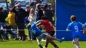 Watch 8-year-old rugby star plow thr ...