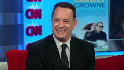 Hanks pokes fun in newsroom, talks movie