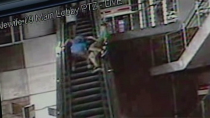 Teen survives fall off escalator. An 18-year-old sits on the handrail of an ...