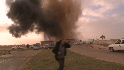 Libyan rebels scramble from bombs