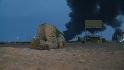 Libyan forces retake rebel towns
