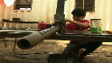 Libyan kids help refurbish weapons