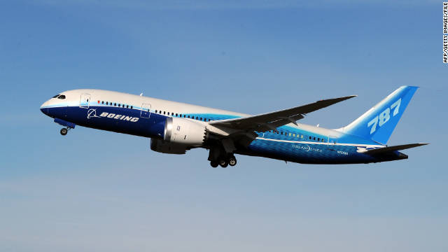 A 787 Dreamliner jet is tested above the Boeing factory at Paine Field in Everett, Washington state on March 20, 2011.