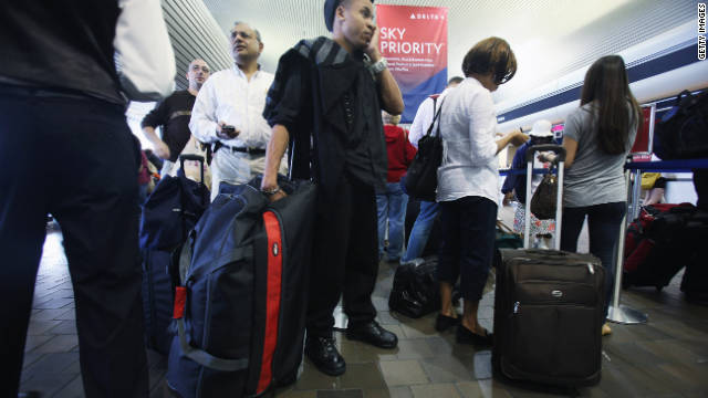 Travelers wait to board their flights at New York's LaGuardia Airport .