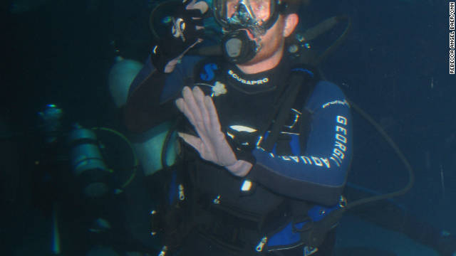 NASCAR driver Brian Vickers goes for a dive at the Georgia Aquarium in Atlanta.