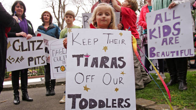 "A girl protests a child beauty pageant hosted by the U.S. company behind ""Toddlers and Tiaras"" in Melbourne, Australia."