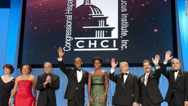 President Barack Obama and First Lady Michelle Obama wave alongside Hispanic members of Congress as they attend the Congressional Hispanic Caucus Institute's gala Wednesday..