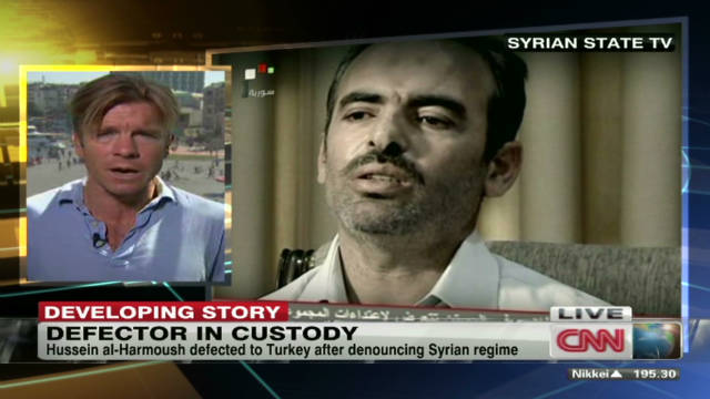 Defector now in Syrian custody?