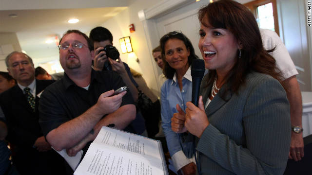 Former U.S. Senate candidate Christine O'Donnell answers questions at a tea party rally on August 18 in Arlington, Virginia.