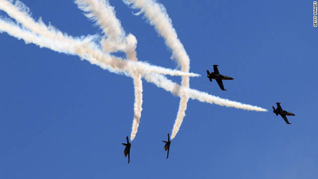 Pilots perform during an air show before an IndyCar race in California.