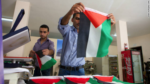 Palestinians make flags in a factory in the West Bank city of Hebron on Wednesday.