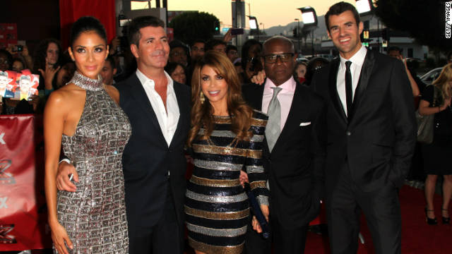 """The X Factor"" judges Nicole Scherzinger, Simon Cowell, Paula Abdul, L.A. Reid, and show host Steve Jones ."