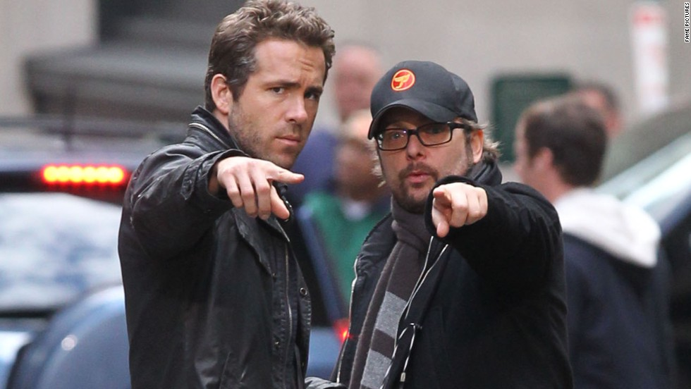"""Loser: Ryan Reynolds, left, starred in two duds, """"R.I.P.D."""" and """"Turbo"""" (for which he supplied the voice of the lead). In Reynolds' defense, """"The Croods"""" -- another voice role for him -- did better."""