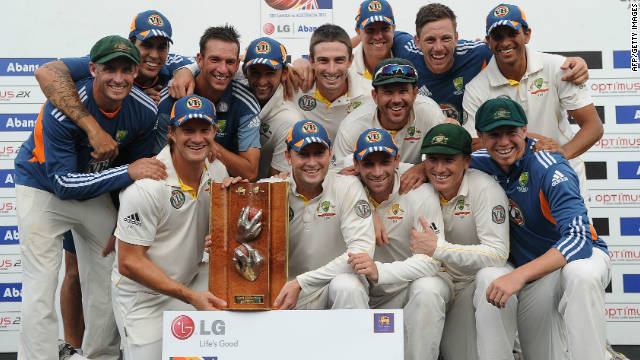 Australia led by captain Michael Clarke (center) celebrate after victory in the Test match series against Sri Lanka in Colombo