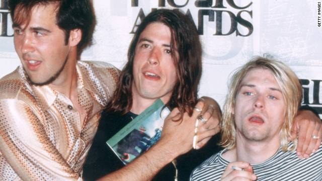 "In 1993, from left, Kris Novoselik, Dave Grohl and Kurt Cobain pose with Kevin Kerslake, who directed the video for ""In Bloom."""