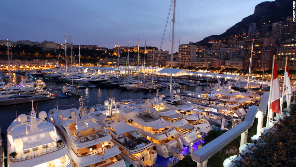 Superyachts moored at Port Hercules during the International Monaco Yacht Show, an event popular with boating enthusiasts.