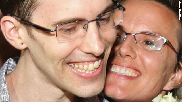 American hiker Shane Bauer, left, is embraced by fiancee Sarah Shourd after his release from Iran on Wednesday.