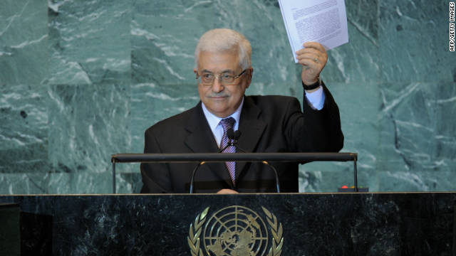 Mahmoud Abbas holds a copy of the letter requesting Palestinian statehood as he speaks at the U.N. on September 23, 2011.