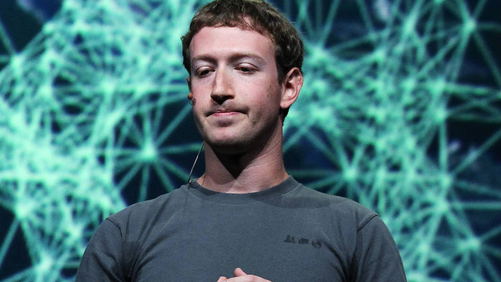 Even Zuckerberg looks a little bored with his T-shirt in this photo.