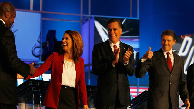 GOP candidates Herman Cain, from left, Michele Bachmann, Mitt Romney and Rick Perry chat before the September 12 debate.