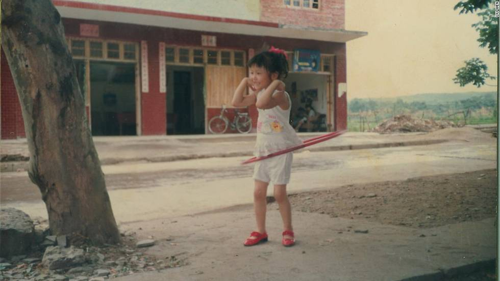 Hula hooping in the street outside her grandmothers house, aged 6. A long way from the runways of the world's fashion capitals.