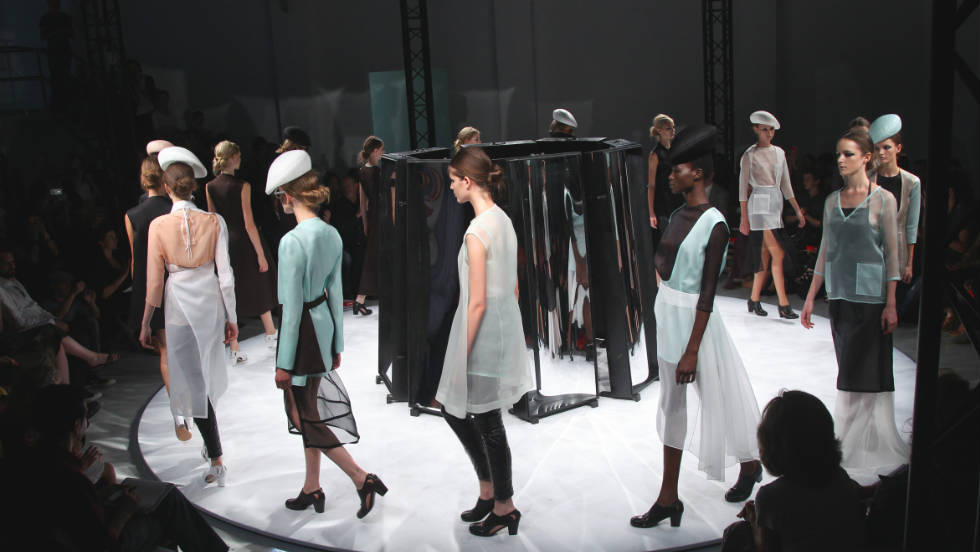 Models exhibit designs by Aganovich during the Spring/Summer 2012 ready-to-wear collection show in Paris.