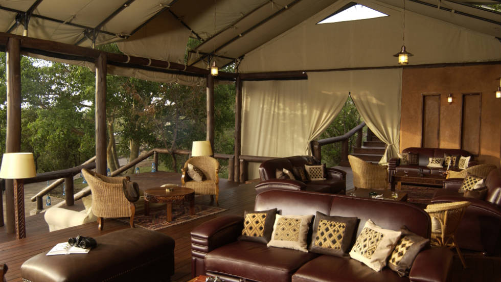 In addition to the luxurious guest tents, a lounge, restaurant, sundecks and swimming pool overlook the vast Tanzanian bush.