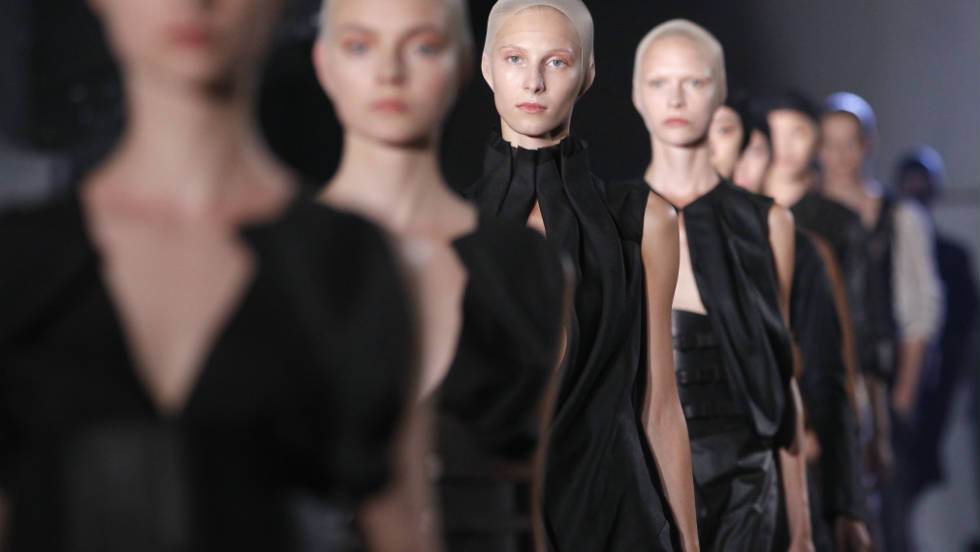 An enigmatic row of models display creations by Dutch designer Josephus Thimister during the Spring/Summer 2012 ready-to-wear collection show.