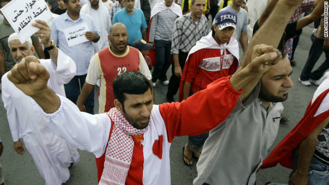 Bahraini Shiite anti-government protesters demonstrate in the streets of Manama on February 27.