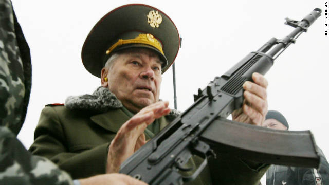 Mikhail Kalashnikov is handed an AK-74, a refined version of the AK-47, on November 23, 2002 in Izhevsk.